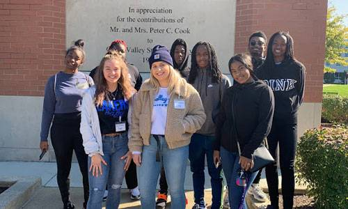 students in front of GVSU clock tower